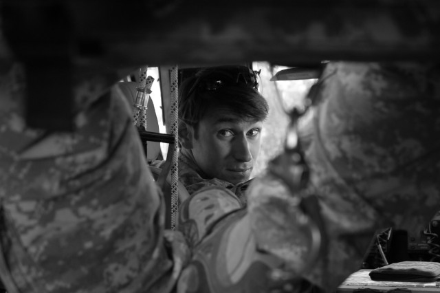 Capt. William Swenson sits in Task Force Chosin mine-resistant, ambush-protected vehicle while conducting a shura, October 2009.