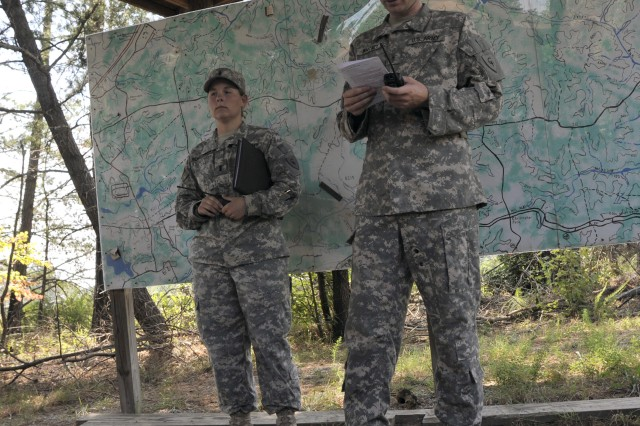 Range Officer in Charge 1st Lt. Chelsea Schellinger (left) and Warrant Officer Charles Whitney (right), the Range Safety Officer, gave a safety briefing before Soldiers took to the sky for aerial gunnery training.