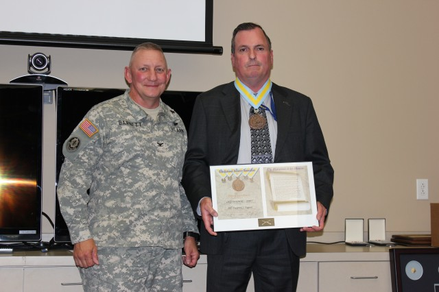 Fred Dupont stands with Colonel Daniel R. Barnett,  Director, Soldier Requirements Division, Training and Doctrine Command Capability Manager Soldier (TCM-Soldier), after being awarded the Order of Saint Maurice for his outstanding contribution to the Infantry. Dupont served over 30 years as an Infantryman including serving as an airborne Ranger, continues to serve as an Army civilian supporting Soldiers.