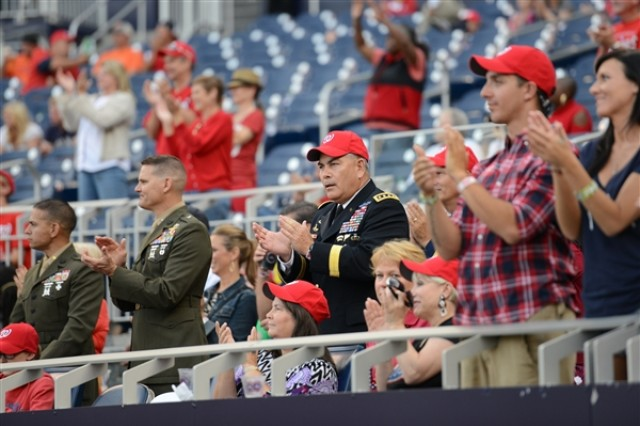 Army Vice Chief of Staff Gen. John F. Campbell (center) applauds as teams are introduced during the third annual Wounded Warriors Celebrity Softball Classic, at Nationals Park in Washington, D.C., Sept. 15, 2013.