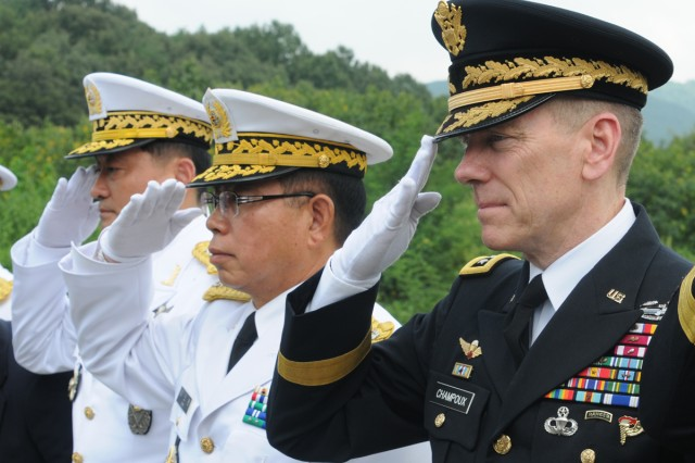Eighth Army Commanding General Lt. Gen. Bernard S. Champoux (right) and Republic of Korea Army 2nd Operational Command Commander Gen. Kim Yo-han (center) salute fallen troops at Hill 303 before the Nakdong River Battle ceremony.