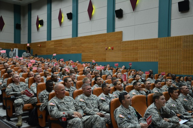 "Camp Casey, South Korea "" Soldiers of 210th Fires Brigade, 2nd Infantry Division, wave their stop signs to indicate that the role player was making a wrong decision during the Sex Signals Production Tour at the Camp Casey Theater Sept. 16. Throughout the show the presenters trained and educated the Soldiers of 210th Fires Bde. on response and prevention of sexual harassment, sexual assault, and gender based misconduct. 210th Fire Bde. goal is to eliminate sexual harassment and sexual assaults by creating a climate that respects the dignity of every member of the Army family. (U.S. Army photo by Staff Sgt. Carlos R. Davis 210th Fires Brigade Public Affairs/Released)."