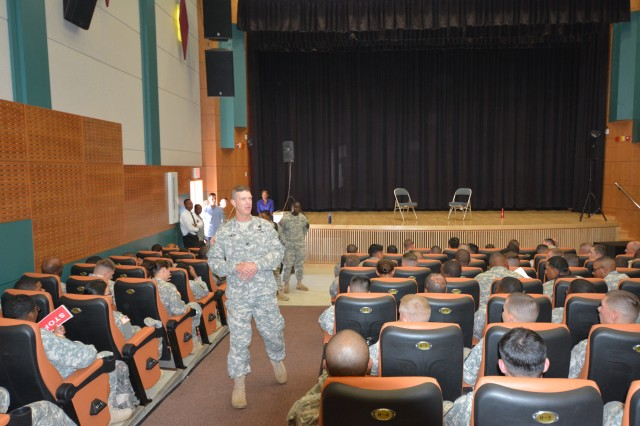 "Camp Casey, South Korea "" Col. Michael Lawson, of Del Haven, N.J., the commander of 210th Fires Brigade, 2nd Infantry Division, provides opening remarks to the Soldiers of the brigade about the importance of eliminating sexual harassment and sexual assaults within their ranks at the Camp Casey Theater Sept. 16. Throughout the Sex Signals show the Soldiers were trained and educated on response and prevention of sexual harassment, sexual assault, and gender based misconduct. 210th Fire Bde. goal is to eliminate sexual harassment and sexual assaults by creating a climate that respects the dignity of every member of the Army family. (U.S. Army photo by Staff Sgt. Carlos R. Davis 210th Fires Brigade Public Affairs/Released)."