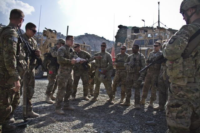 Soldiers with Gunfighter Company, 1st Battalion, 506th Infantry Regiment, 4th Brigade Combat Team, 101st Airborne Division (Air Assault), listen to a ramp brief prior to going on a mission to pull security for the 1438th Engineer Multi-Role Bridge Company at their build site near the village of Laka Tiza, Afghanistan, Sept. 2. (U.S. Army photo by Sgt. Justin A. Moeller, 4th Brigade Combat Team Public Affairs)