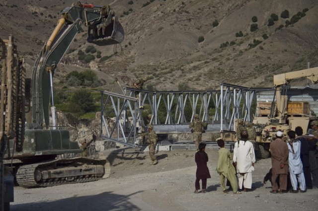 Villagers watch as U.S. Army soldiers with the 1438th Engineer Multi-Role Bridge Company, from the Missouri National Guard, construct a Mabey-Johnson bridge in the village of Laka Tiza, Afghanistan, Sept. 2, 2013. (U.S. Army photo by Sgt. Justin A. Moeller, 4th Brigade Combat Team Public Affairs)