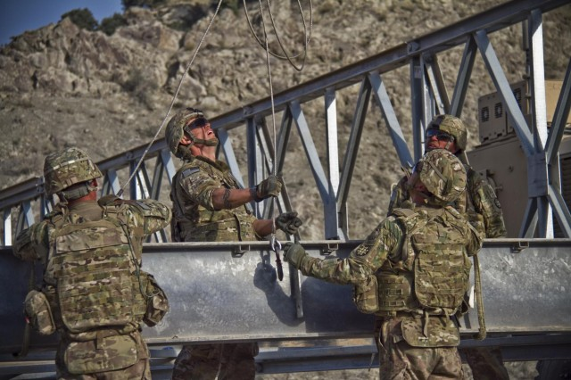 U.S. Army soldiers with the 1438th Engineer Multi-Role Bridge Company, from the Missouri National Guard, construct a Mabey-Johnson bridge in the village of Laka Tiza, Afghanistan, Sept. 2, 2013. (U.S. Army photo by Sgt. Justin A. Moeller, 4th Brigade Combat Team Public Affairs)