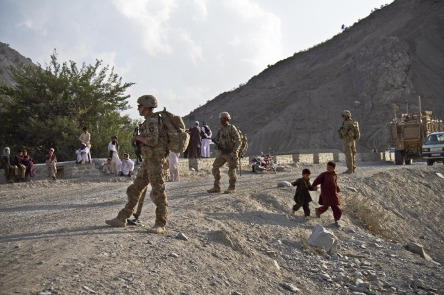U.S. Army soldiers with Gunfighter Company, 1st Battalion, 506th Infantry Regiment, 4th Brigade Combat Team, 101st Airborne Division (Air Assault), pull security for the 1438th Engineer Multi-Role Bridge Company at their build site near the village of Laka Tiza, Afghanistan, Sept. 2, 2013. (U.S. Army photo by Sgt. Justin A. Moeller, 4th Brigade Combat Team Public Affairs)