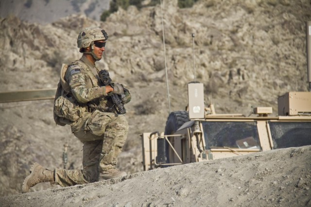 U.S. Army Pfc. Edwin Grau, an infantryman with Gunfighter Company, 1st Battalion, 506th Infantry Regiment, 4th Brigade Combat Team, 101st Airborne Division (Air Assault), pulls security for the 1438th Engineer Multi-Role Bridge Company at their build site near the village of Laka Tiza, Afghanistan, Sept. 2, 2013. (U.S. Army photo by Sgt. Justin A. Moeller, 4th Brigade Combat Team Public Affairs)