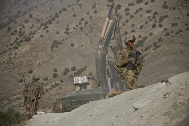 As an excavator works on the bridge site, U.S. Army Pfc. Edwin Grau, an infantryman with Gunfighter Company, 1st Battalion, 506th Infantry Regiment, 4th Brigade Combat Team, 101st Airborne Division (Air Assault), pulls security for the 1438th Engineer Multi-Role Bridge Company near the village of Laka Tiza, Afghanistan, Sept. 2, 2013. (U.S. Army photo by Sgt. Justin A. Moeller, 4th Brigade Combat Team Public Affairs)
