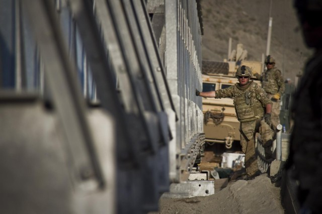A U.S. Army soldier with the 1438th Engineer Multi-Role Bridge Company, from the Missouri National Guard, monitors the progress of a Mabey-Johnson bridge as it rolls across the span it is intended to cover, near the village of Laka Tiza, Afghanistan, Sept. 2, 2013. (U.S. Army photo by Sgt. Justin A. Moeller, 4th Brigade Combat Team Public Affairs)