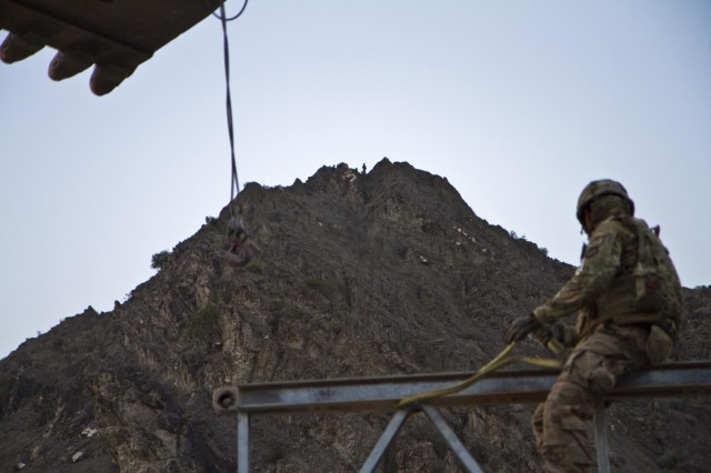 U.S. Army soldiers with Gunfighter Company, 1st Battalion, 506th Infantry Regiment, 4th Brigade Combat Team, 101st Airborne Division (Air Assault), pull security from a mountain top for the 1438th Engineer Multi-Role Bridge Company at their build site near the village of Laka Tiza, Afghanistan, Sept. 2, 2013. (U.S. Army photo by Sgt. Justin A. Moeller, 4th Brigade Combat Team Public Affairs)