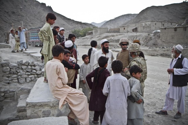 With the assistance of an interpreter, an U.S. Army soldier with the 1438th Engineer Multi-Role Bridge Company, from the Missouri National Guard, talks to villagers of Laka Tiza, Afghanistan, about the construction of the Mabey-Johnson bridge, Sept. 2, 2013. (U.S. Army photo by Sgt. Justin A. Moeller, 4th Brigade Combat Team Public Affairs)