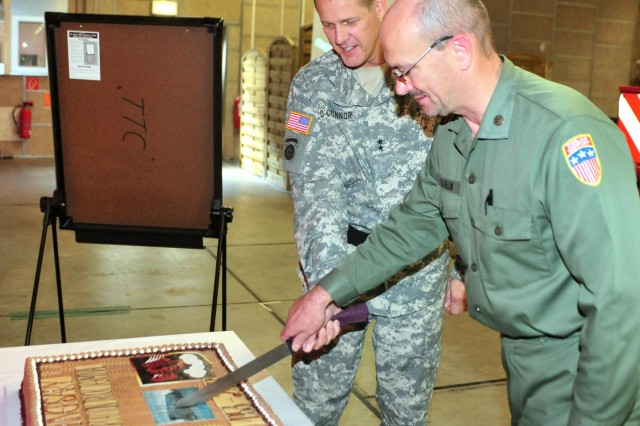 Maj. Gen. John R. O'Connor, the commanding general of the 21st Theater Sustainment Command, and Winfried P. Wilhelm, the superintendent of the 6966th Transportation Truck Terminal and a native of Bexbach, Germany, cut the 6966th TTT ceremonial cake during the organization's 60th anniversary ceremony on Rhine Ordnance Barracks Sept. 13.