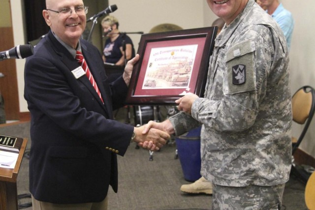 Lt. Col. Charles Blumenfeld, commander of the 49th Transportation Battalion, 4th Sustainment Brigade, 13th Sustainment Command (Expeditionary), presents a Certificate of Appreciation to guest speaker, retired U.S. Navy Chaplain Ron Swafford. Swafford was presented with the certificate and other tokens of appreciation for coming to talk to the Wrangler soldiers, in particular the younger soldiers, about the events of 9/11 during a Memorial Prayer Breakfast at the Spirit of Fort Hood Chapel, Sept. 11, 2013. (Photo by Sgt. 1st Class Chris Bridson, 4th Sust. Bde. PAO, 13th ESC.)