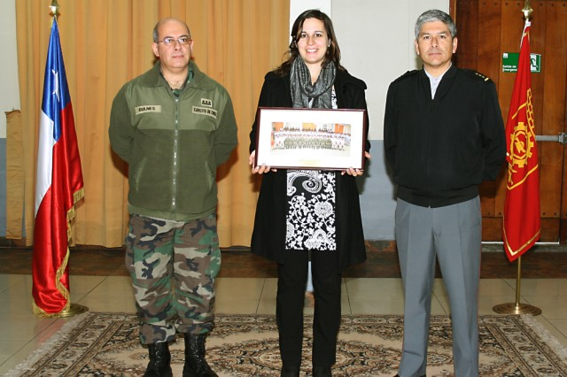 From left: Crl. Miguel Bulnes, sub director of the Chilean Army's Institute of Research and Control; Jasmine Serlemitsos, participant in the U.S. Army Engineer and Scientist Exchange Program; and Crl. Hernan Araya, director of IDIC, in Santiago, Chile, July 12, 2013.
