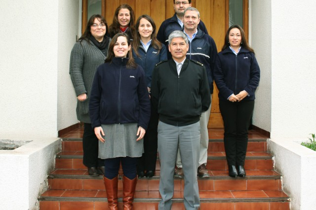 Front row, from left: Jasmine Serlemitsos, participant in the U.S. Army Engineer and Scientist Exchange Program, and Crl. Hernan Araya, director of the Chilean Army's Institute of Research and Control, in Santiago, Chile, July 4, 2013. Second row, from left: Alejandra Ester Diaz, Carolina Vidal, Ricardo Navarte, Catherine Santis. Third row, from left: Marta Vega, Jamie Lorenzo Kong.