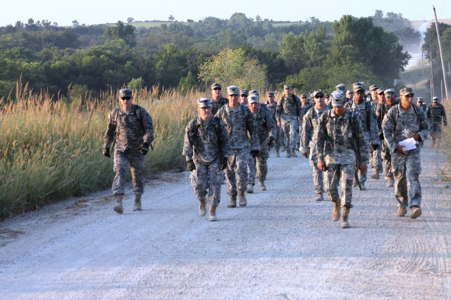 Col. John Reynolds II, commanding officer of the 1st ABCT, 1st Inf. Div., and Command Sgt. Maj. Mark Kiefer, the brigade's senior noncommissioned officer, lead Soldiers on a six-a-half-mile road march Sept. 6 in rural Manhattan as part of Operation Krypteia. The event was designed to test leaders' mental and physical toughness.