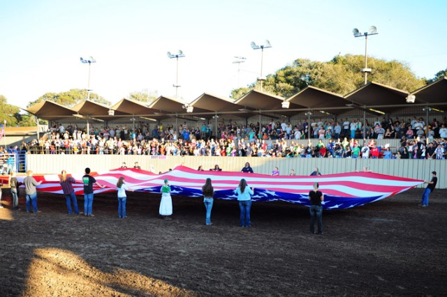 "PRESIDIO OF MONTEREY, Calif. "" A 50-foot American flag is unveiled inside the Monterey Fairground's Pattee Arena during a special flag ceremony and military dedication."