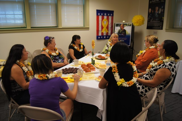FORT SHAFTER, Hawaii -- Gold Star Mothers enjoy a Gold Star Mother's Day Tea hosted by Survivor Outreach Services; Army Community Service; Directorate of Family and Morale, Welfare and Recreation; U.S. Army Garrison-Hawaii, Sept. 23, 2012, here. Lis Olsen (far center, at head of table) is the SOS program manager.