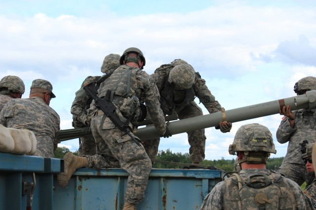 U.S. Army Reserve Soldiers from the 479th Engineer Battalion, 411th Engineer Brigade, 412th Theater Engineer Brigade, prepare equipment for the Mine Clearing Line Charge operation exercise during the monthly Battle Assembly during July at Fort Drum.