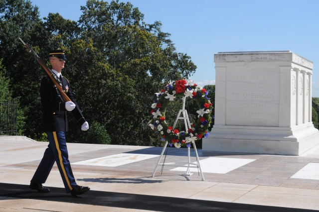 A Tomb Sentinel guards the Tomb of the Unknown Soldier following a wreath laying at the Tomb of the Unknown Soldier at Arlington National Cemetery September 18, 2013.