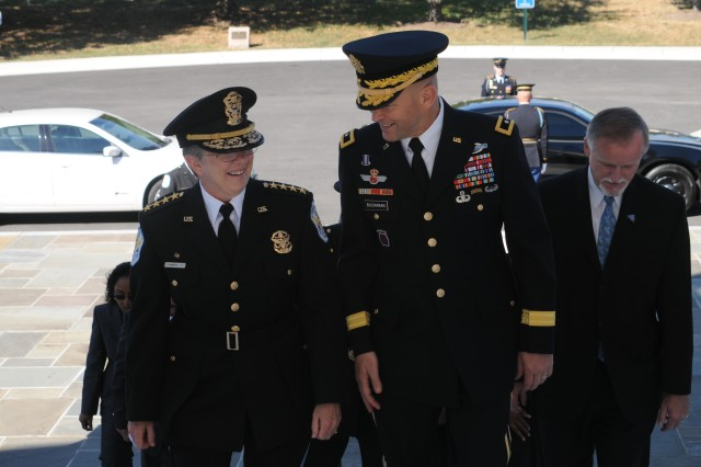 Maj. Gen. Jeffrey S. Buchanan JFHQ-NCR/MDW Commanding General walks with U.S. Park Police Chief Teresa Chambers prior to a full honors wreath laying ceremony at the Tomb of the Unknown Soldier at Arlington National Cemetery September 18, 2013.