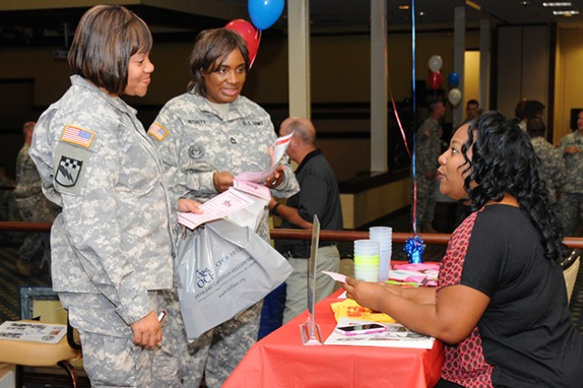 CW2 Joie Smith and Master Sgt. Etola Nesbit, both of 164th Theater Airfield Operations Group, get their bingo cards stamped and learn more about Girls Inc., from Sylvia McCall, program director for Girls Inc., during the 2013 CFC kickoff event Sept. 16.