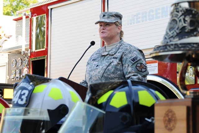 Lt. Col. Madeline Bondy, provost marshal and director of public safety, talks during a 9/11 commemoration ceremony in front of the Fort Rucker Fire Station Sept. 11.