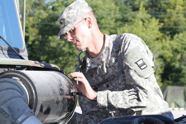 Sgt. Anthony Frey, of Fort McCoy, Wis., and assigned to the 3/399 Logistics Support Battalion checks the engine of a military vehicle during the third annual 800th Logistics Support Brigade Truck Rodeo Competition at Ft. Knox, Ky., Sept. 12-14. Frey won second place in the mechanic category of the competition.