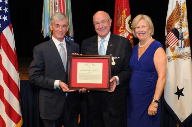 Secretary of the Army John McHugh presents Thomas R. Lamont, the retiring assistant secretary of the Army for Manpower and Reserve Affairs, with the Distinguished Civilian Service Award Medal, the Pentagon, Sept. 19, 2013. Also pictured is Lamont's wife, Bridget.