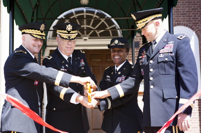 "(From the left) Deputy Chief of Chaplains, U.S. Army Chaplain Corps Chap. (Brig. Gen.) Charles ""Ray"" Bailey, chief of chaplains, U.S. Army Chaplain Corps Chap. (Maj. Gen.) Donald L. Rutherford, Joint Base Myer-Henderson Hall Commander Col. Fern O. Sumpter and Joint Force Headquarters/National Capital Region U.S. Army Military District of Washington Commander Maj. Gen. Jeffrey S. Buchanan cut the ribbon during a ceremony at Old Post Chapel Sept. 18. Old Post Chapel has been under renovations for eight months."