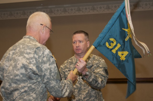 Lt. Col. Stephen G. Harlan relieves Lt. Col. Timothy B. Smith as commanding officer of the 314th Press Camp Headquarters during a change of command ceremony held at the Hilton Doubletree hotel, in Birmingham, Ala., Sept. 15, 2013. Smith relinquishes the unit guidon to Brig. Gen. Douglas Satterfield, the deputy commanding general of the 412th Theater Engineer Command to signify passing his leadership along to the new commander of the 314th PCH.