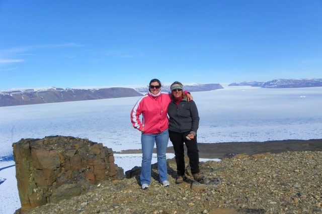 U.S. Army Corps of Engineers Detroit District environmental assessor Amanda Cruz, with Fort Worth District site coordinator Marjorie Courtright, were part of a bundled-up crew that worked with Defense Logistics Agency officials at Thule Air Base, Greenland, in June. The remote base north of the Arctic Circle gets one flight a week. A month later Cruz performed environmental assessments in Japan in shirt sleeves.