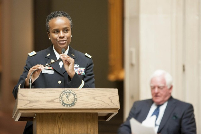 "Joint Base Commander Col. Fern O. Sumpter was invited to speak at the inauguration of the National Gallery of Art's ""Tell It With Pride"" exhibit Sept. 10 in Washington."