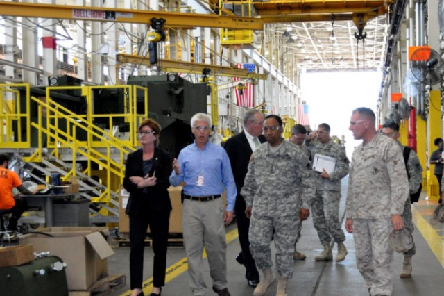 Army Materiel Command Commanding General Gen. Dennis L. Via joins Marine Corps Logistics Command Commanding General Maj. Gen. John J. Broadmeadow for a tour of the Production Plant in Albany, Ga. The leaders discussed collaborative efforts to support the joint warfighter.