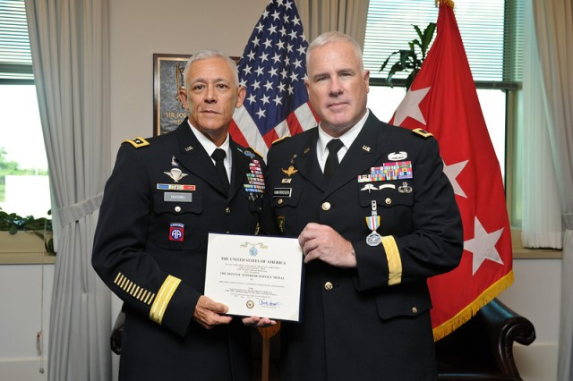 Brig. Gen. Hugh Van Roosen receives the Defense Superior Service Medal for his 15 months as the force chief of staff for the UN Mission in Liberia, at the Pentagon, Arlington, Va., Sept. 13, 2013.