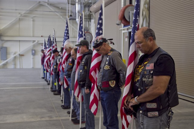"Members of the Patriot Guard Riders at the memorialization ceremony for the SPC Christopher Fox Tactical Equipment Maintenance Facility on September 14. The Patriot Guard Riders (PGR) is an organization in the United States which attends the funerals of members of the armed forces, firefighters, and police at the invitation of the deceased's family. The organization is open to any persons, regardless of political affiliation, veteran status, or whether or not they ride motorcycles, as long as they have ""a deep respect for those who serve our country"". In addition to attending funerals, the group also greets troops returning from overseas at homecoming celebrations and performs volunteer work for veteran's organizations such as Veterans Homes."