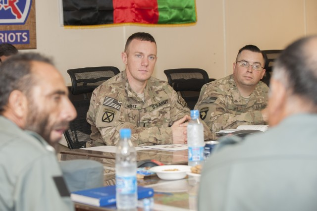 """NANGARHAR PROVINCE, Afghanistan """" U.S. Army 1st Lt. Greg Lambert, (center) of Lilburn, Ga., and Maj. Robert Tarr, both members of Security Forces Advisory and Assistance Team Blue, listen to provincial leaders in the Afghan Uniformed Police during a meeting at Forward Operating Base Fenty, Nangarhar Province, Afghanistan, Sept. 12, 2013. Team Blue gained a better understanding of the AUPs operations, training and equipment to counteract roadside bombs in Nangarhar Province. (U.S. Army National Guard photo by Staff Sgt. Julieanne Morse, 129th Mobile Public Affairs Detachment/RELEASED)"""