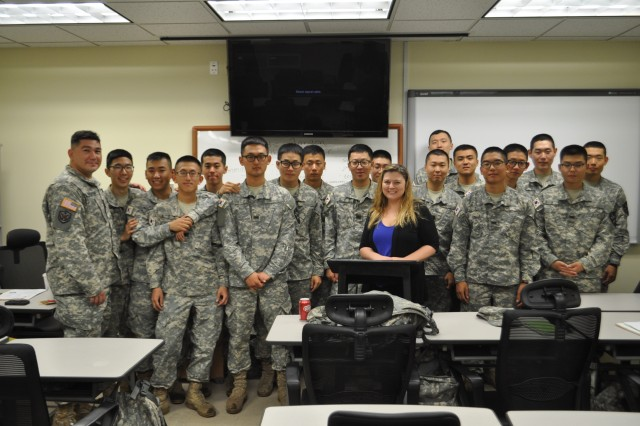 "CAMP CASEY, South Korea "" Kandida Gendron, teacher of the English class, and KATUSAs from 70th Brigade Support Battalion, 210th Fires Brigade, 2nd Infantry Division, pose for a photo in Casey education center on Camp Casey, South Korea September 11, 2013."