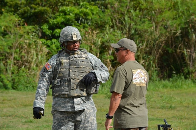 SSGT James Beal, 10th Regional Support Group, talks with USARPAC instructor Aaron Nakashima prior to a hands-on IED simulation at Camp Hansen on Okinawa.