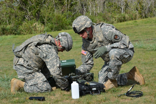 Soldiers from 1-1 Air Defense Artillery, 53rd Signal Battalion and 10th Regional Support Group work in teams as they learn how to use Improvised Explosive Device Effects Simulation training kits during a training exercise on Camp Hansen on Sept. 19, 2013.