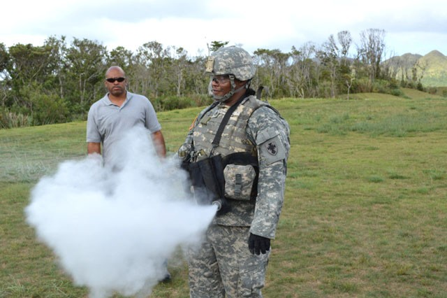 SSGT James Beal, 10th Regional Support Group, demonstrates a simulation with a suicide vest during IEDES training on Okinawa on Sept. 19, 2013.