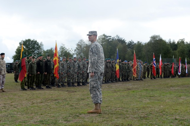 Representative formations from 40 nations, including the U.S., gather on a Camp Aachen parade field at the Joint Multinational Training Command's Grafenwoehr Training Area, Germany, Sept. 12, 2013, to mark the start of the U.S. European Command's Exercise Combined Endeavor 2013.  This annual event explores and resolves multinational tactics, techniques and procedures while building command, control, communication and computers planning experience and knowledge among participating nations.