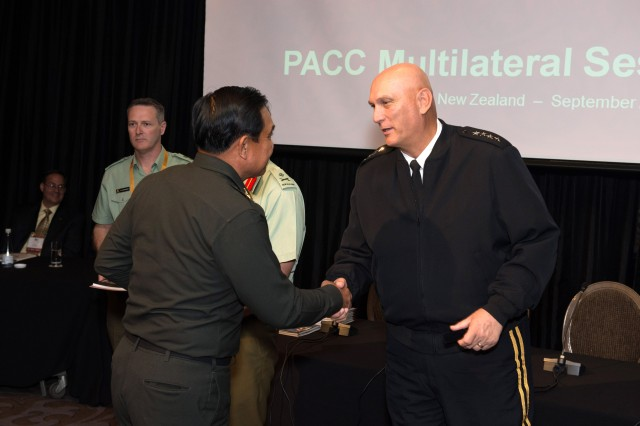 U.S. Army Chief of Staff Gen. Ray Odierno presents gifts as a token of appreciation to attendees of the 8th Pacific Armies Chiefs Conference in Auckland, New Zealand Sept. 11, 2013. (U.S. Army photo by Staff Sgt. Teddy Wade/ Released)