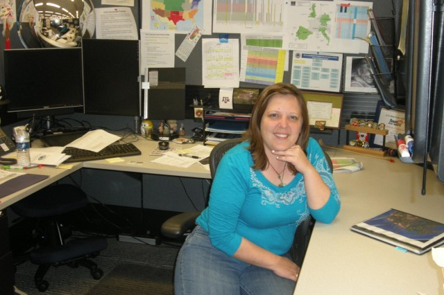Site coordinator Misty Chisum, shown here in the Fort Worth District, plays an important role in leading her team on installation visits for the U.S. Army Corps of Engineers program supporting the Defense Logistics Agency. USACE is assessing DLA facilities worldwide to help the agency reach its financial statement audit goals under the Chief Financial Officers Act of 1990.