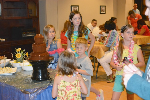 Kids began lining up early to dig into the chocolate fountain at the Deployed Spouse Luau at Havana's on Torii Station on Sept. 21, 2013.