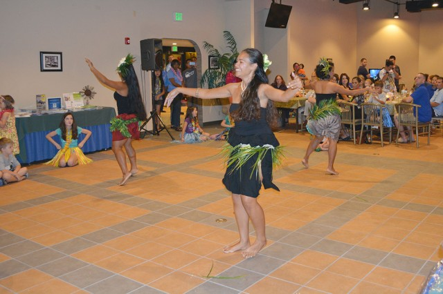 Hula dancers from the local group Hui Nohona Aloha perform during the Deployed Spouse Luau at Havana's on Torii Station on Sept. 21, 2013.