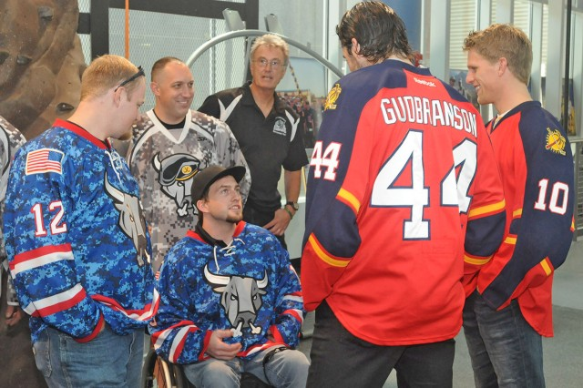 FORT SAM HOUSTON, Texas - Eric Gudbranson and Joey Crabb, both members of the Florida Panthers professional hockey team, meet with wounded warriors at the Center for the Intrepid Sept. 19 during a familiarization tour to observe some of the  innovative treatment being performed with the Soldiers. After their stop at the CFI, the players went on to meet with Soldiers and families at the Warrior and Family Support Center.