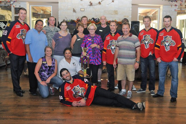 FORT SAM HOUSTON, Texas - Shawn Matthias (left), Mike Weaver, Joey Crabb, Brad Boyes, and Erik Gudbranson (front), all members of the Florida Panthers professional hockey team, gather with Warrior and Family Support Center staff members and volunteers Sept. 19. During their visit, the players swapped stories with the wounded warriors and their families.