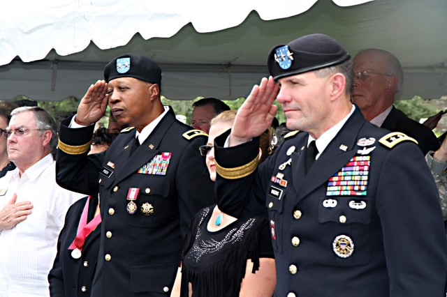 FORT SAM HOUSTON, Texas - Maj. Gen. Adolph McQueen Jr. (left), deputy commanding general for support, U.S. Army North (Fifth Army), salutes the colors of the nation for the last time alongside Lt. Gen. Perry Wiggins, commanding general for Army North and senior commander for Fort Sam Houston and Camp Bullis, during his retirement ceremony Sept. 17 in the historic Quadrangle. McQueen enlisted in the U.S. Marine Corps in 1971 and was directly commissioned into the Michigan National Guard in 1982.